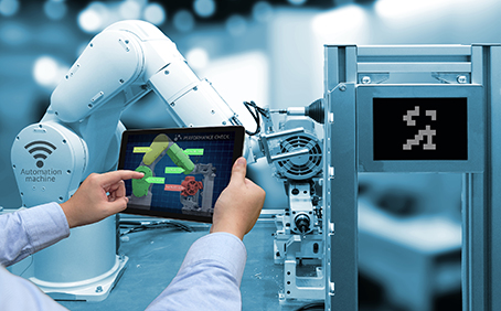 Industry 4.0 concept . Man hand holding tablet with performance